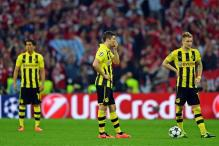Dortmund advance to Champions League quarters despite 2-1 loss