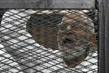 Egypt puts Muslim Brotherhood leader, 682 others on trial