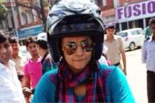 Gul Panag blazes the campaign trail on a Royal Enfield bike