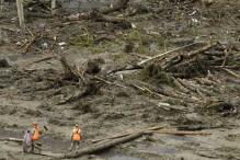 Mudslide death toll rises, rains expected to ease