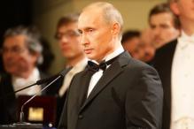 Putin formally gets Crimea; Ukraine, EU sign deal