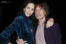 Mick Jagger's girlfriend and designer L'Wren Scott found hanging from a scarf