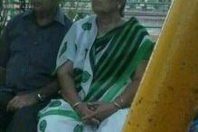 Snapshot: Photo of woman wearing saree with  WhatsApp logo printed all over it conquers Indian Facebook timelines