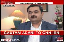 Not received any land for pittance from Modi government: Adani