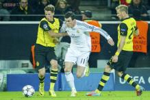 Real Madrid survive Borussia Dortmund scare to reach Champions League semi-finals