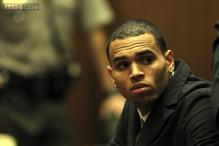 Rapper Chris Brown's bodyguard confesses to punching a man who tried to board Brown's tour bus