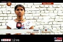 CJ Kiran, a first time voter demands basic sanitation facilities in a Delhi slum