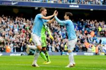 Title race memories give Manchester City's Dzeko hope