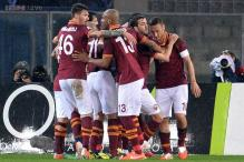 Roma brush Milan aside to keep title hopes alive