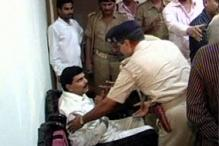 Half a dozen policemen suspended for allowing a jailed Bihar leader to use mobile phone in court premises