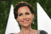 Minnie Driver hits back at critics by posting nude photos on Twitter