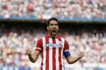 Atletico Madrid stay on course for surprise La Liga title