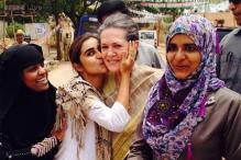 Digvijaya tweets picture of Sonia getting kissed by a well-wisher