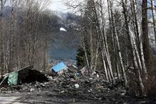 US: Waters recede, helping search for mudslide victims