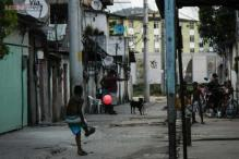 Photographer hands over his camera to children playing street football in Brazil to capture raw passion