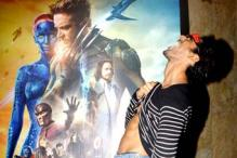 Stargaze: Prateik lifts his shirt up in from of an 'X-Men' poster to pose for the shutterbugs