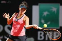 Casey Dellacqua tops Elena Vesnina at Strasbourg International