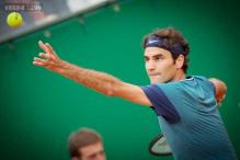Federer suffers early defeat in Rome, Nadal survives