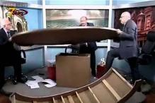 Watch: Journalists break into a fight, overturn and break a studio table during a live debate on Syria in Jordan