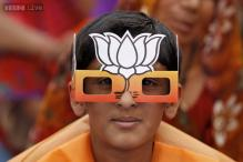 Photos: The lotus has bloomed: how BJP supporters backed Narendra Modi with masks and lotuses