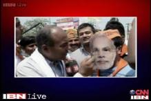 Watch: BJP supporter in Varanasi flaunts Modi mask