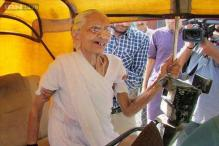 Snapshot: Narendra Modi's mother Hiraben arrives in an autorickshaw to cast her vote; his wife Jasodaben seen casting her vote in Mahesana