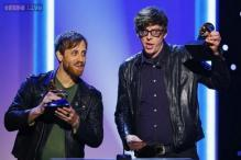 Black Keys score Billboard No. 1, hold off Jackson and Parton