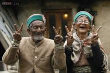 Snapshot: India's oldest voter couple shows the victory sign urging the youth to cast their votes
