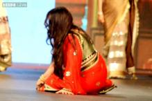 Snapshot: Poonam Dhillon trips over her sari while walking the ramp for Vikram Phadnis