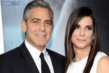 Why is Sandra Bullock upset about George Clooney's engagement to Amal Alamuddin?