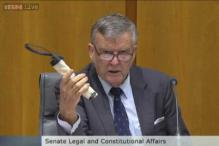 Australian senator startles colleagues by producing a fake bomb at a hearing