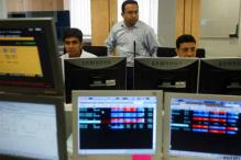 Sensex surges 319 points to new closing peak; SBI zooms 10 pc