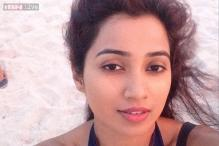 Snapshot: Is that really you, Shreya Ghoshal? The singer is almost unrecognisable as she 'gets beachy' during vacation