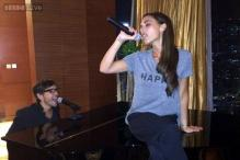 'Posh Spice' Victoria Beckham gives an impromptu performance at a Singapore bar