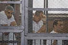 France denounces Egypt's decision to sentence journalists