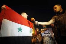 As civil war rages, Syrians vote for President