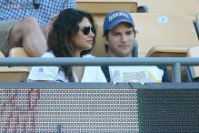 Mila Kunis and Ashton Kutcher cosy up at baseball game