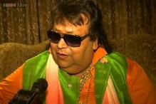 'O Ole Ole'! Is it rap? Is it pop? Is it poetry? Listen to Bappi Lahiri sing his latest World Cup football song