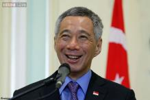 Blogger sued by Singapore PM fired from job