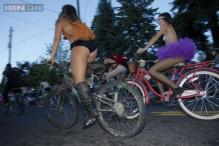 Thousands of naked bicyclists stage festive Portland protest ride