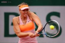 Sharapova grinds down Stosur to reach French Open last eight