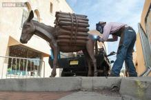 Santa Fe's famous donkey statue gets a new tail after it was mysteriously stolen!