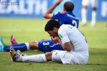 World Cup 2014: FIFA bans Uruguay's Suarez for four months for biting opponent