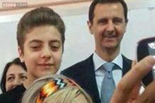 Syrian President Assad poses for a 'selfie' with his wife after voting for his own re-election