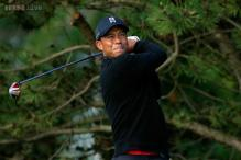 Chalmers sets pace at Congressional, Woods toils