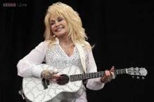 Country star Dolly Parton offers to adopt an abandoned dog named after her if the canine's owners don't come forward