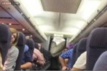 United Airlines plane's evacuation slide deploys mid-flight