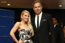 Jessica Simpson walks down the aisle with Eric Johnson