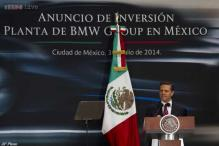Mexican president signs law restricting telecoms