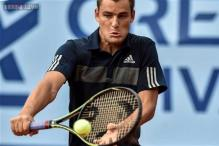 Titleholder Mikhail Youzhny advances at Swiss Open
